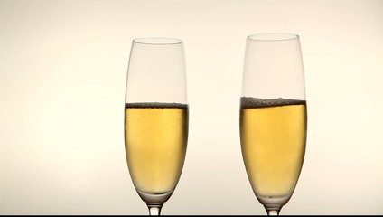 Two glasses with champagne toasting