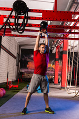 kettlebell swinging man weightlifting workout gym