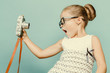 child holding a instant camera - 71912440