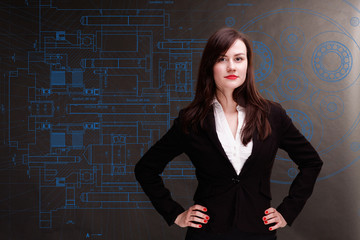 Young businesswoman with blueprint