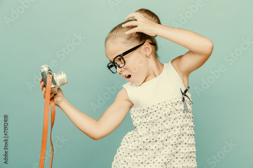 child holding a instant camera - 71912408