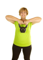 Middle Age Woman Lifting A Kettlebell on White Background