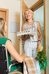 Female bringing food to invalid