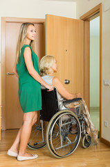 Girl helping handicapped woman