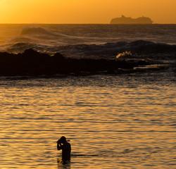 Man snorkeling at sunset