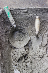 Mason mortar tools in cement mixing trough