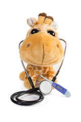 Plush toy giraffe smiling with stethoscope and thermometer