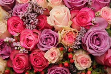 purple and pink roses wedding arrangement