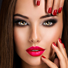 seductive woman with dark brown eye makeup and bright red lips a