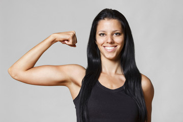 Girl showing off biceps