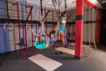 Gym girls muscle ups rings swinging workout
