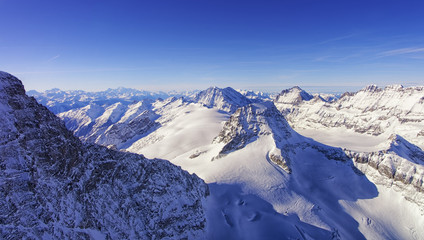Peaks chain skyline and valley in Jungfrau region helicopter vie
