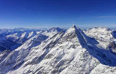 Peak in Jungfrau region helicopter view in winter