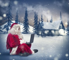Santa Claus with laptop