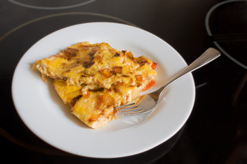 scrambled eggs with carrots and onions on a white plate