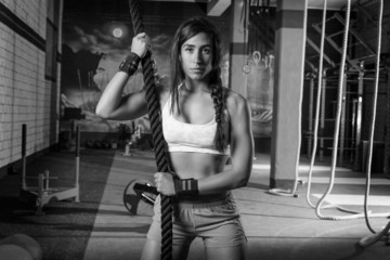 beautiful fitted girl at gym with black rope
