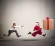 Angry man chasing Santa Claus