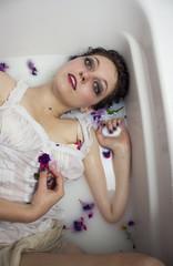 Woman in tub of milk