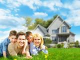 Fototapety Happy family near new home.