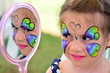 Little girl getting her face painted