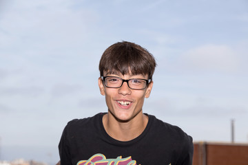 boy with glasses smiles