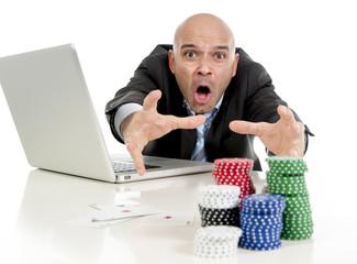 internet gambling addict businessman loosing money online poker