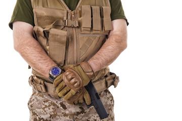 Soldier man holding his gun.
