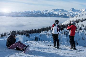 Skiers watching sunset
