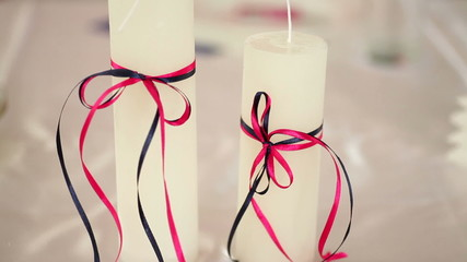 beautiful white candles on a table bride and groom