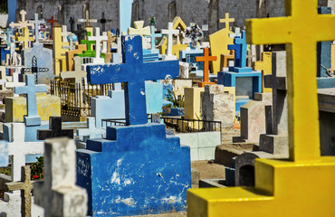 Tombstones and crosses in cemetery