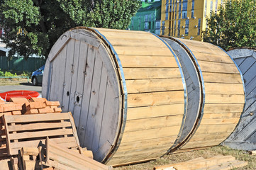 Wooden coil of electric cable on plant yard