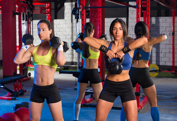 Gym women with barbell and kettlebell workout