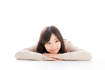 young asian woman relaxing on white background