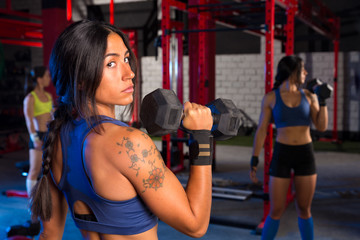 Gym women with hex barbell workout