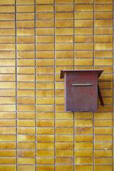 Postbox on Yellow tiles wall