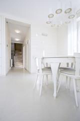 Round small table in bright interior