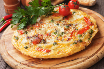 Tortilla, spanish omelet with potato and vegetables