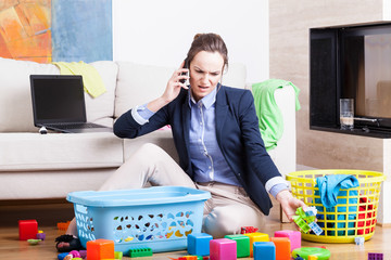 Mother organising toys and working