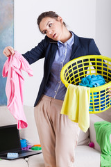 Businesswoman holding a laundry basket