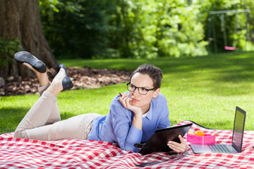 Businesswoman working with documents outdoors