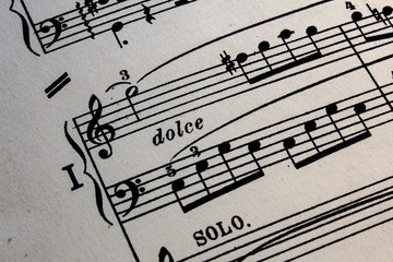 Sheet music background, dolce sign;