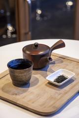 Japanese tea set with tea leaf on wood tray