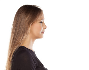 Profile portrait of young woman on white background