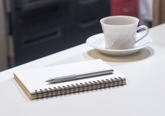 Notepad and coffee on Working table