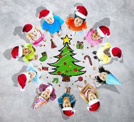 Kids with Christmas Hats and Tree in Background