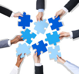 Group of Hands Holding Jigsaw