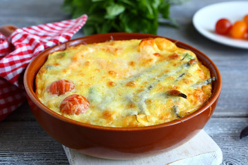 Vegetables baked with cheese in a pan