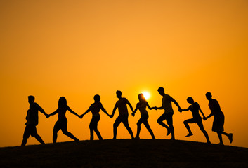 Silhouette of People Walking on the Hill