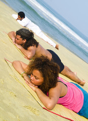 Yoga Class By The Beach Lying Face Down