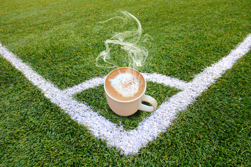 Hot coffee on green grasses